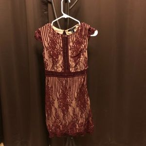 Burgundy laced dress with open back